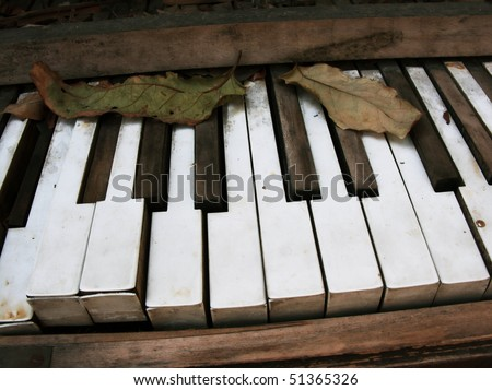 Broken Old Piano Keys - stock photo