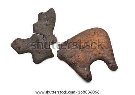 Broken overcooked biscuit - stock photo