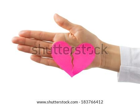 Broken paper heart on hand - stock photo