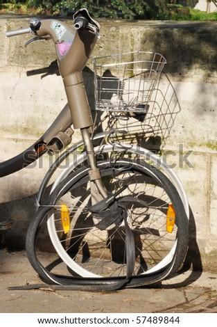 Broken parisian bicycle - stock photo