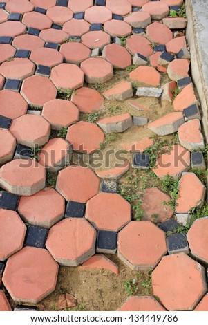 Broken paving stone - stock photo