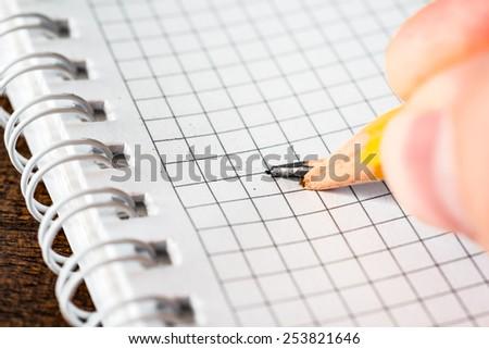 Broken pencil in hand - stock photo