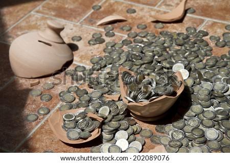 Broken piggy bank - stock photo