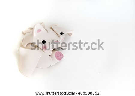 broken piggy bank on white background . copy space for text. failure of investment concept.