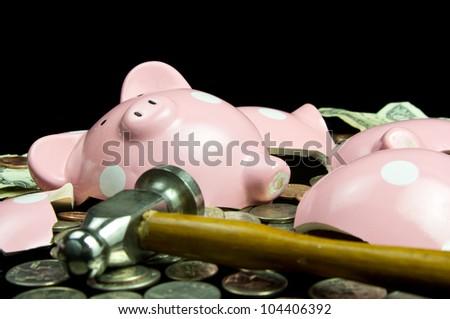 Broken piggy bank with cash & coins - stock photo