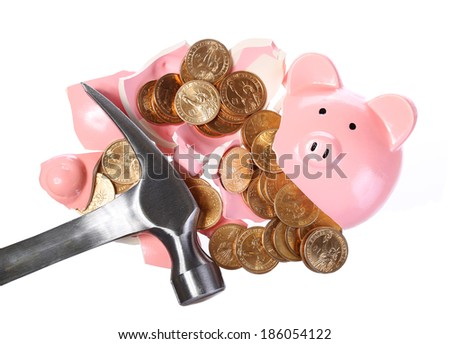 Broken Piggy Bank with Gold Coins and Hammer isolated on white. Money Concept - stock photo