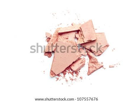 broken pink eyeshadow on white background - stock photo