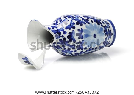 Broken Porcelain Vase Lying on White Background
