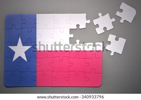 broken puzzle with the flag of texas state on a gray background          - stock photo