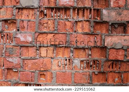 Broken red brick wall - stock photo