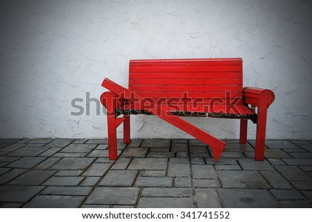 Broken red chair on a white background - stock photo