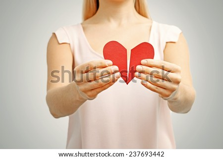 broken red heart in woman hands. concept of relationship, divorce, pain - stock photo