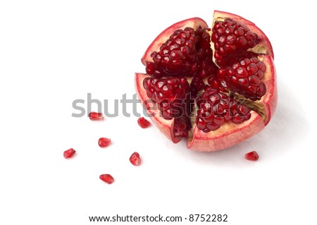 broken ripe pomegranate fruit and seeds over white cloth. isolated. - stock photo