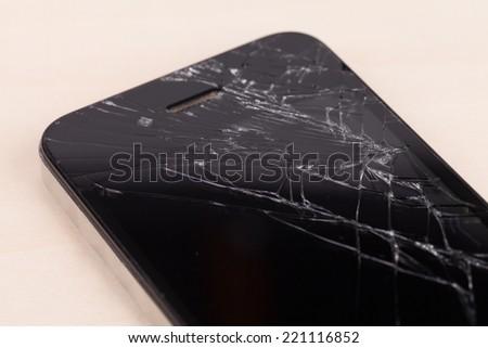 Broken screen smartphone - stock photo