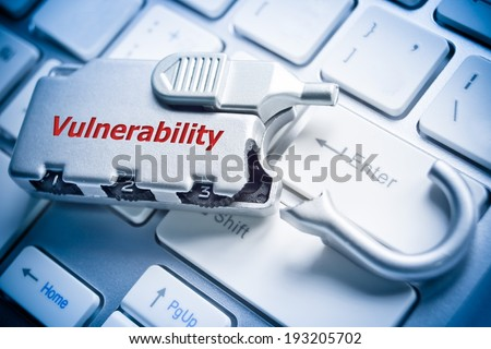 broken security lock on computer keyboard - vulnerability issue in computing - stock photo