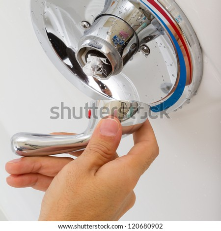 Broken Shower faucet cold and hot water in the bathroom - stock photo