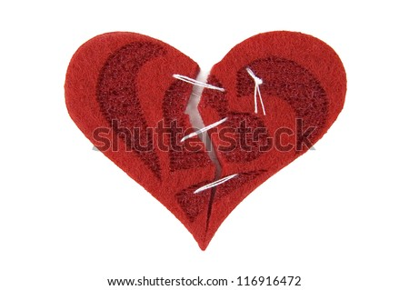 Broken: textile heart cut into parts and sewed together. Isolated on white - stock photo