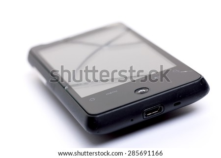 Broken touch glass on smart mobile phone. On white. Bokeh. Small depth of field. - stock photo