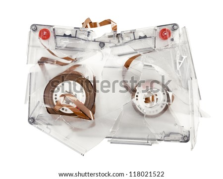 Broken transparent audio cassette on white background - stock photo