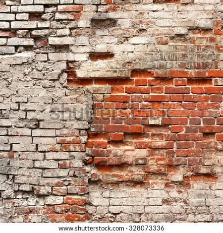 Broken Vintage Bricklaying Wall Fragment From Old Red White Clay Bricks And Damaged Plaster Frame Background Texture Close-up - stock photo