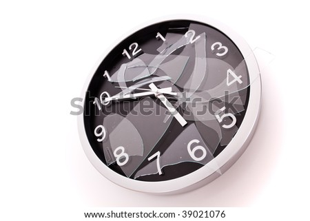 broken wall clock over a white background - stock photo
