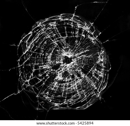 Broken window, looks like a bullet hole. - stock photo
