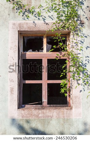 broken window of a ruined house - stock photo