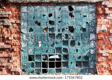 Broken windows of old industrial building. Background  - stock photo