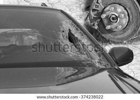 Broken windscreen at black car in traffic accident and disc brake - stock photo