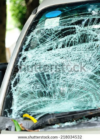 broken windshield of car by typhoon - stock photo