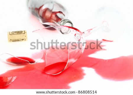 Broken wine glass and spilled red wine - stock photo