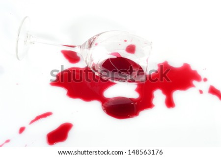 Broken wineglass isolated on white