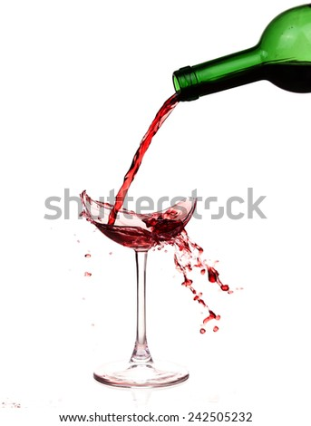 Broken wineglass on the table. Poured red wine, like blood. - stock photo