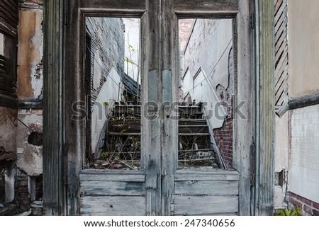 Broken wooden doors at abandoned building in Jerome Arizona - stock photo