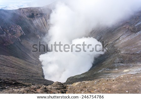 bromo crater with gas smoke - stock photo