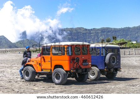 BROMO, INDONESIA - JULY 23, 2016: Unidentified tourists sitting on 4x4 Jeep for rent at Mount Bromo in East Java, Indonesia. Mount Bromo is one of the most visited tourist attractions