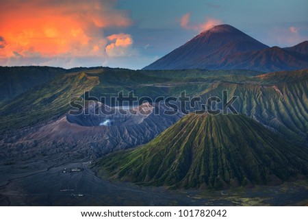 Bromo volcano (left) in Tengger Semeru National Park at sunrise. Java, Indonesia - stock photo