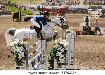 BROMONT-CANADA JULY 22: Unknown rider on a horse during 2011, International  Bromont on July 22, 2011 At the Equestrian Olympic Park 1976 - stock photo