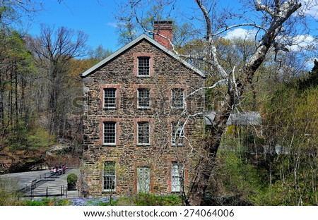 Bronx, New York - April 29, 2015:  The 1840 Old Stone Mill on the Bronx River at the New York Botanical Garden  * - stock photo
