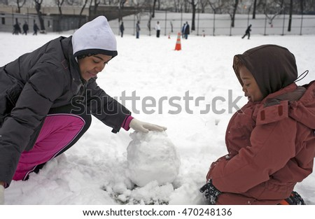 BRONX, NEW YORK - FEBRUARY 22: Mother with child play with snow in park after snow storm.  Taken February 22, 2009, in  New York.