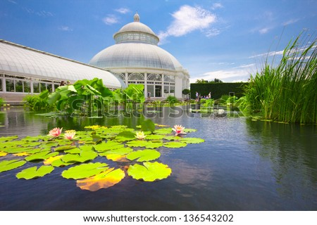 BRONX, NY - JUNE 1: Water Lilly Pond at conservatory in New York Botanical Garden in the Bronx, NYC on June 1, 2012. The Victorian greenhouse is an architectural centerpiece at this 250 acre garden. - stock photo