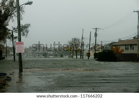 BRONX, NY - OCTOBER 29:  Hurricane Sandy begins it's wrath and starts flooding homes near the water in Bronx, NY, U.S., on Monday, October 29, 2012. - stock photo