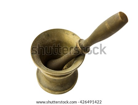 Bronze ancient mortar and pestle to grind coffee. Elegant classic coffee beans. Heavy metal coffee mortar.  - stock photo
