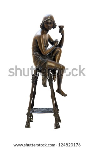 Bronze antique figurine of naked woman sitting on the chair. Isolated image.