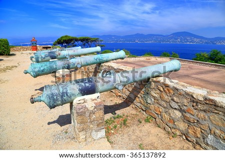 Bronze barrels of old canons on the walls of Saint Tropez fortress, French Riviera, France - stock photo