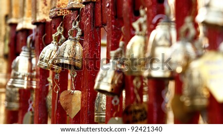 Bronze bells in Doi Suthep buddhist temple in Chiang Mai, Thailand - stock photo
