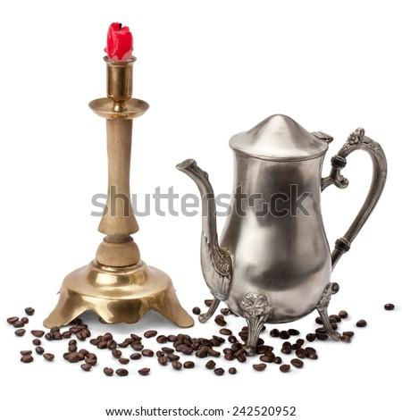 bronze candelabra, candle, silver coffee pot - stock photo