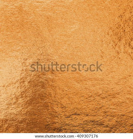 bronze color decorative texture paper: Bright brilliant festive glossy metallic look textured empty wallpaper backdrop: Aluminium tin metal material craft design decoration - stock photo
