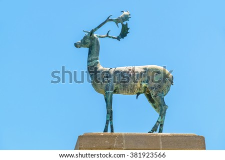Bronze deer statue at the entrance to Mandraki harbour. Rhodes, Greece - stock photo