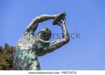 bronze discobolus from the Panathenaic Stadium in Athens (that hosted the first modern Olympic Games in 1896) - stock photo